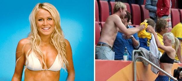http://www.ligafutbol.net/wp-content/2011/07/josefine_oqvist_se_quita_la_camiseta_y_se_la_da_a_un_fan.jpg
