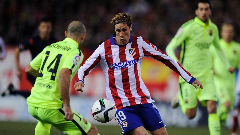 Fernando Torres y Javier Mascherano