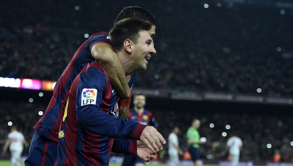 Messi y Suarez celebrando un gol