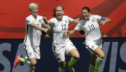 From left, United States' Megan Rapinoe, Lauren Holiday, and Carli Lloyd celebrate after Lloyd scored her