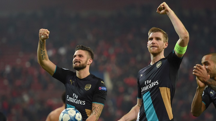 Giroud y Mertesacker