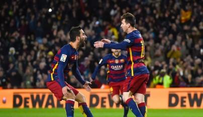 Arda Turan y Messi