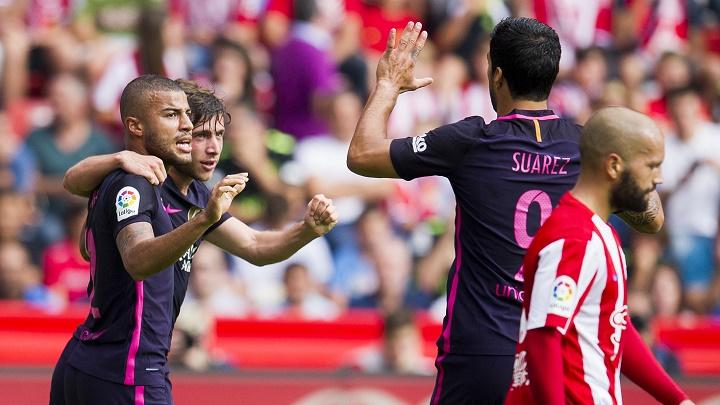 Sergi Roberto Rafinha y Luis Suárez
